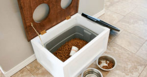 Pet Food Bins and Dog Bowls on the Kitchen Floor | Diamond Pet Foods