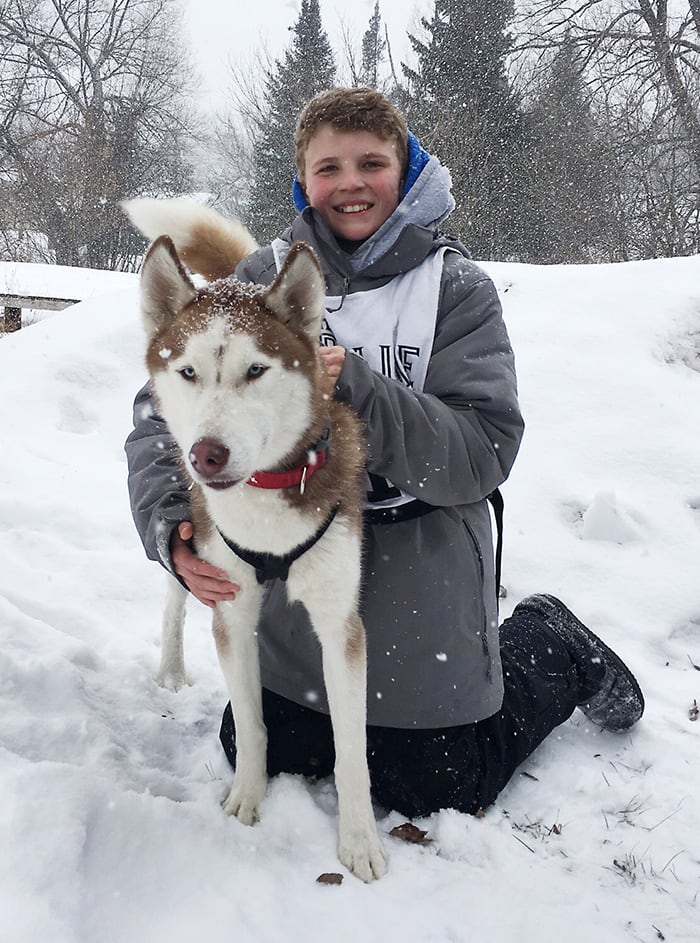 Kid and Siberian Husky Outside in the Snow | Diamond Pet Foods