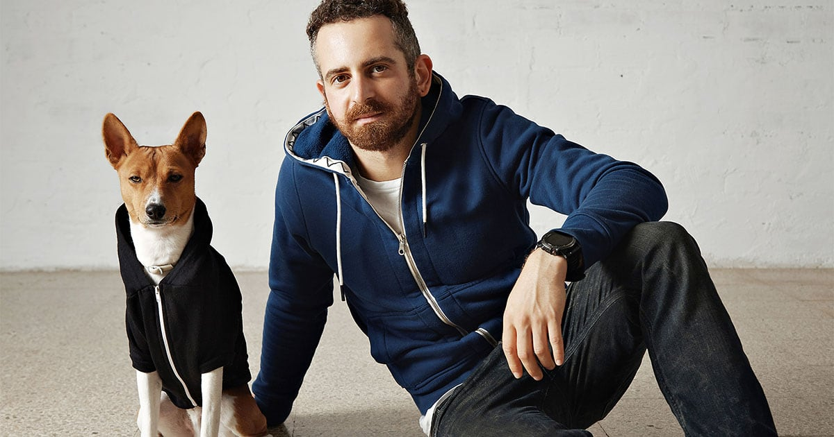 Dog and Owner Wearing Hooded Sweatshirts | Diamond Pet Foods