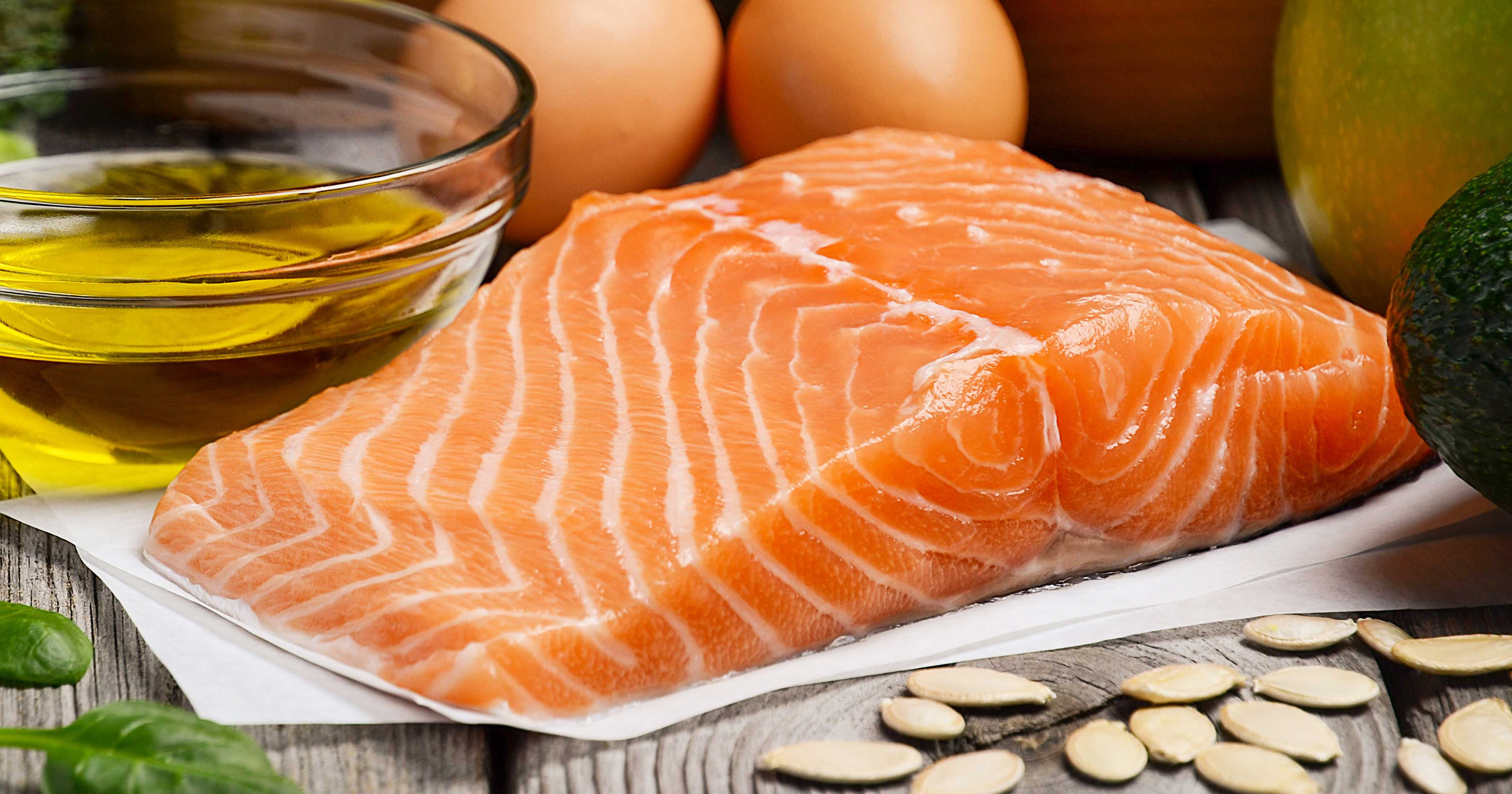 Food Photography of Salmon Near Oil Bottle and Eggs | Diamond Pet Foods